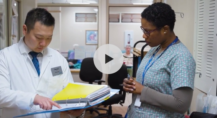 Video preview image of two nurses discussing paperwork
